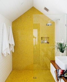 """The eye-catching yellow gloss tiles in the main ensuite bathroom are from BetterTiles in Sydney. Yellow is one of Holly's favourite colours. """"Sunshine-yellow creates a happy vibe,"""" she says"""