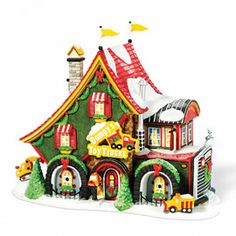 """Department 56: Products - """"Dumpy's Toy Trucks"""" - View Lighted Buildings. Retired north pole"""