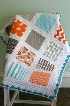 Modern Baby quilt – squares were cut at 6 1/2″.  sashing was cut at 2 1/2″.  outer border was cut at 4″.  Used jumbo ric rac under binding.