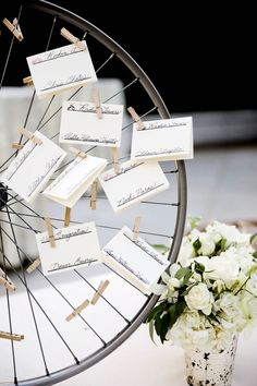 Bicycle themed wedding ideas: Use a wheel as an escort card display