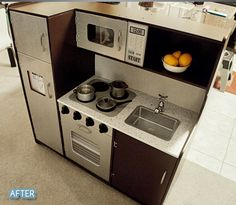 I have this kitchen (in the before picture).  Totally going to do this to make it less girlie for the boy :)