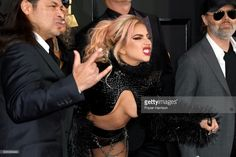 Singer Lady Gaga (C) with (L-R) musicians Robert Trujillo and Lars Ulrich of Metallica attend The 59th GRAMMY Awards at STAPLES Center on February 12, 2017 in Los Angeles, California.  (Photo by Frazer Harrison/Getty Images)