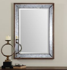 Uttermost Daria Mirror. Antiqued, beveled mirror frame accented with an aged, pecan stained solid wood outer frame. May be hung horizontal or vertical.