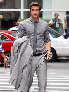 Get ready to swoon: Liam Hemsworth wearing, ahem, 50 shades of grey in NYC.  http://www.people.com/people/gallery/0,,20625057,00.html