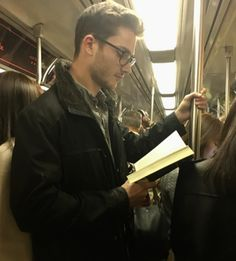 How come I don't get to stumble upon #hotdudesreading like this whenever I board the train?