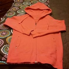 Coral hooded jacket. Fabric looks like long john material. 100% cotton. Love the color!! Weatherproof Jackets & Coats