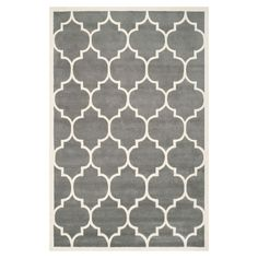 Bring a touch of warmth to your bedroom or study with this wool rug, featuring neutral hues and a trellis pattern. Use to define spaces in your living room o...