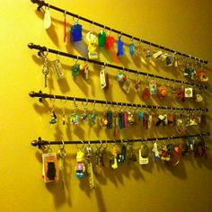 My mom had collected key chains, they were passed on to me and I wanted to find a creative way to display them. Bought small rods. Very inexpensive and great conversation piece.