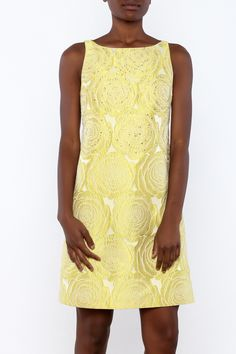 e434179d939 Yellow beaded sheath dress with a boat neckline, full lining and an exposed  zipper closure. Shoptiques