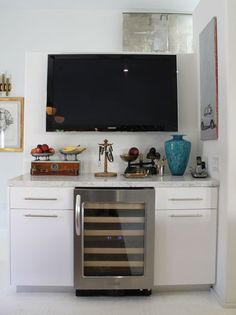 integrate wine fridge into a small side cabinet - don't like this one (or the HUGE tv above it) but want to remember to think about this idea for the kitchen