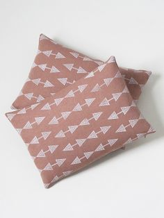 pair of copper arrow cushions– susan connor new york
