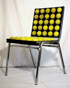 DIY tennis ball chair: cut tennis ball in half and put on old muffin baking tin!