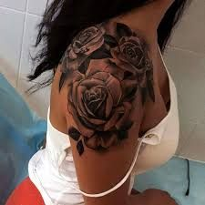 My next tattoo (or something similar, in color). Putting someone's name in a rose tattoo means you would die for them. This one will be for my babies.