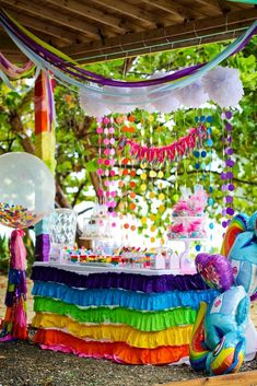 "My Little Pony Birthday Party Table - love the rainbow ruffle table cloth and rainbow ""rain"" and clouds backdrop. The Streamers are great colors."
