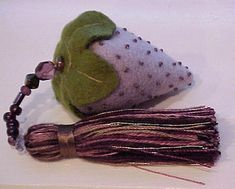 sand-filled strawberry pincushion--love the bead accents--pretty and functional!