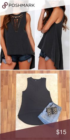 Cool Cutout Tank, High-Low Hem Love this black top with a cutout design and high-low hem! Soft material. Could be worn by a large as well. New in original packaging. Tops Tank Tops