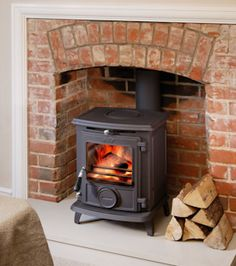 A woodburning stove with lots of lovely reclaimed bricks around it to provide thermal mass. LOVE the idea but would need to do alot of checks to make sure the chimmey has no leaks and ventilated, also permits due to those flats next door :S