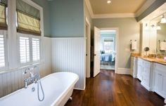 More hardwood flooring ideas -- love the wainscotting as contrast.