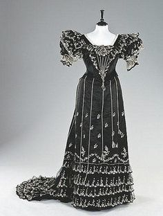 A striking black satin and tamboured tulle evening gown, circa 1893-4, labelled W Tebbs & Sons, Brighton  Kerry Taylor Auctions