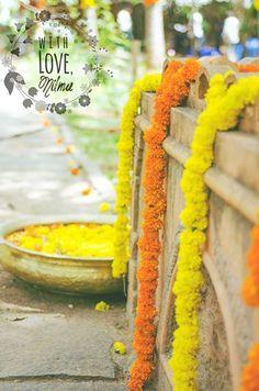 Beautiful yellow and orange marigolds to brighten up your Monday blues #wedding #weddingplanner #indianwedding #yellow #orange #flowers #marigold #decor #pattern #urli #outdoor #bangalore #stylist #withlovenilma