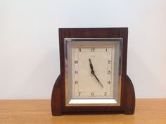 ART DECO CLOCK PERIOD PIECE IN NICE CONDITION, LOVELY SHAPE.