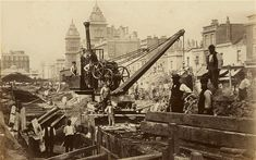 "The coming of the railways transformed London. This picture shows construction workers or ""navvies"" on the Metropolitan District Railway at Praed Street around 1867. The roof of the new Paddington Underground station can be seen in the distance."