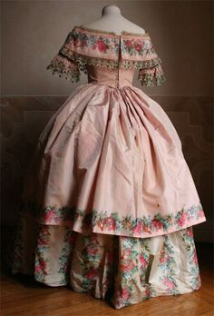 c. 1850- gorgeous dress! Love how the bertha was done out of the print. Very nice!