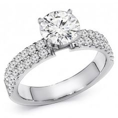 Diamond Engagement Ring. You can customize the center stone between 0.50ct-1.00ct round brilliant cut diamond. Surrounded by 0.75ct total round diamonds on the side. Handcrafted in 14k Gold, 18k Gold, or Platinum 950 setting.