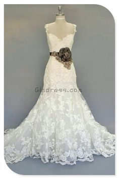 vintage wedding dress. I want it without that giant flower and with a pink pair of cowboy boots.