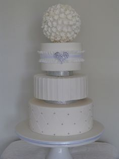 White Wedding With Bling inch cakes seperated with bling spacers and topped with large hydrangea flower ball. Round Wedding Cakes, White Wedding Cakes, Bling Cakes, Fancy Cakes, Wedding Cake Decorations, Dessert Decoration, Pretty Cakes, Beautiful Cakes, Jewel Cake