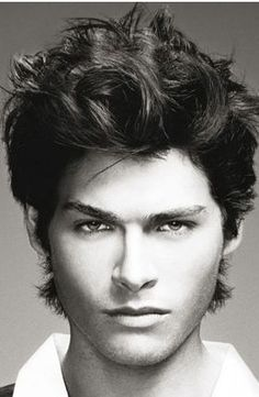 Wavy medium man hairstyle with hot top