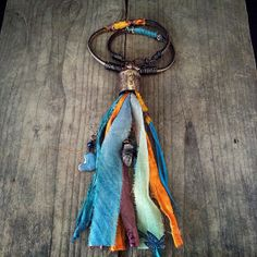 Sari silk tassel, raw crystal, wrapped feather and leather necklace / boho necklace, bohemian, colorful necklace, rustic jewelry