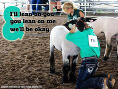 That is me and my lamb Tina. My mom took that picture last year at my county fair.