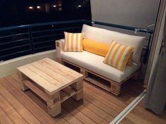 recycled pallet cushioned sofa and coffee table