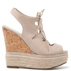 Beige suede platform with laces and elastic ban at the ankle. Features cork platform decorated with rope.