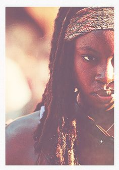 Michonne from The Walking Dead. Talk about a badass bitch. And a gorgeous one, at that.
