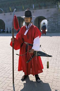 Ceremonial Korean Guard in Traditional Costume at the Gyeongbokgung Palace in Seoul Korea