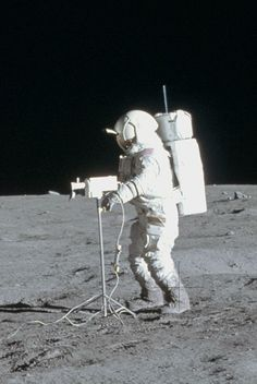 February 5, 1971 — Apollo 14 astronaut Alan Shepard photographs spaceman Ed Mitchell as he pans across the surface of the Moon with his video camera.