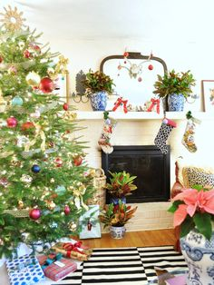 chinoiserie style christmas decorations--blue and white ceramics, greek key ribbon garland, black and white striped rug, colorful and happy