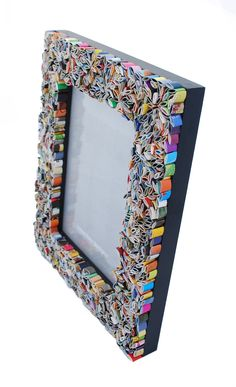 Recycle old magazines...  picture frame - made from recycled magazines. $62.00, via Etsy.