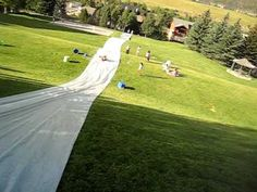 I WANT TO DO THIS !!! http://www.youtube.com/watch?v=MZiYXEGP3VM A bunch of guys made an incredible neighborhood slip & slide and my husband (Brandon) is the first to make it all the way to the bottom!!! UPDATE: NEWEST VERSION OF THIS SLIP & SLIDE (shot on 9/15/2012) WITH WATER FROM THE EAGLE RIVER FIRE DEPART...