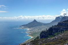 The 6th of our #52capetownhikes challenge! From left to right from our viewpoint on Judas Peak Robben Island Camps Bay Lion's Head  Table Mountain being enveloped in clouds and the 12 Apostles. Busted my ankle yesterday so it was a bit of a schlepp up here but loved every moment! #lovecapetown #sunday #robbenisland #lionshead #campsbay #tablemountain #12apostles #ocean #sea #oudekraal #dayhike #southafrica #outdoors #travel #newhome by ginny_on_the_road http://ift.tt/1ijk11S