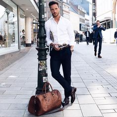 Wear it simple. White shirt and black pants. Ready to go. Men's classy style