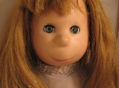 This was my favorite doll that I got for Christmas. I used to push her nose in and then squeeze her face on either side to pop it back out again. =)