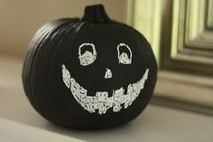 Chalkboard painted pumpkin. Make a new face every day!