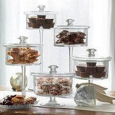 pedestal glass jars - easy to make with clear apoxy & candleholders from the dollar store