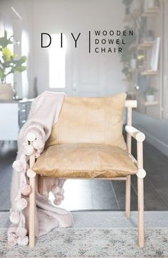 This DIY Urban Outfitters Inspired Wooden Dowel + Leather Chair adds so much bohemian, scandi vibe to your living room! | Vintage Revivals