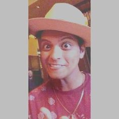 Bruno Mars and his funny faces when it's picture time! He is still so cute though