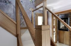 Close up shot of this beautiful, centrally-positioned oak and glass staircase.