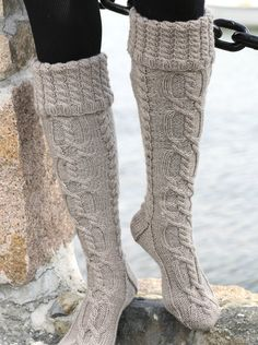Hand knit knee socks. Wool socks. House knee socks. Autumn and winter. Leg warmers. Girl and woman.